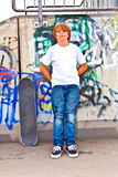Boy resting with skate board Royalty Free Stock Image