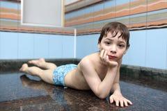 Boy resting in Turkish Bath Stock Image