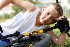 Boy rests with the bike Stock Photography