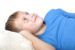 Boy rests upon pillow Stock Photography