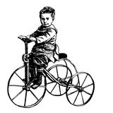 Boy on retro bicycle. Engraving style vector illustration Stock Photos