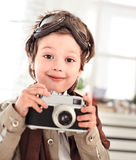 Boy with retro camera Royalty Free Stock Photography