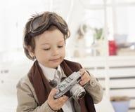 boy with retro camera Royalty Free Stock Photos