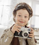 boy with retro camera Royalty Free Stock Images
