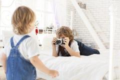 Boy with retro camera Stock Image
