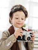 Boy with retro camera Stock Photo
