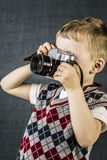 A boy and a retro camera Royalty Free Stock Images