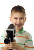 The boy with a retro movie camera Royalty Free Stock Images