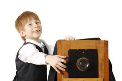 Boy retro photographer with vintage camera Stock Image
