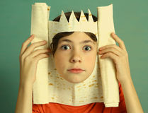 Boy rich imagination acting king with pita bread Royalty Free Stock Image
