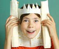 Boy with rich imagination represent king. Preteen handsome boy with rich imagination represent king with pita bread crown happy smiling close up photo on blue Stock Images