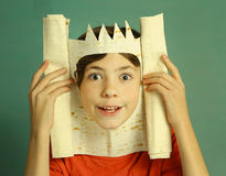 Boy with rich imagination represent king. Preteen handsome boy with rich imagination represent king with pita bread crown happy smiling close up photo on blue Royalty Free Stock Photo
