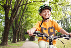 Boy ride a bicycle in city park Royalty Free Stock Photo