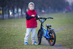 Boy ride a bicycle in city park Royalty Free Stock Image