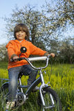Boy ride bikes Stock Images