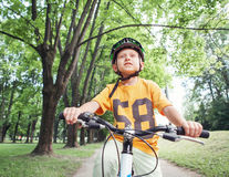 Boy ride his bicycle Stock Photography