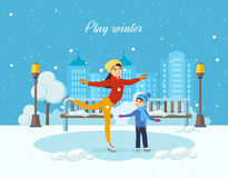 Boy ride on the ice, mom shows master class. Royalty Free Stock Photo