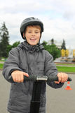 Boy ride on segway near friendship fountain. Little boy ride on segway near friendship fountain, cone in Moscow, Russia, half body stock photo