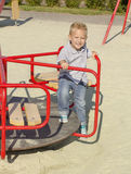 Boy ride on a swing Royalty Free Stock Image