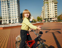 Boy Rider bike in the city Stock Images