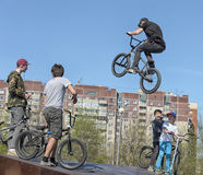 Boy rider jumps during an event of freestyle Royalty Free Stock Photography