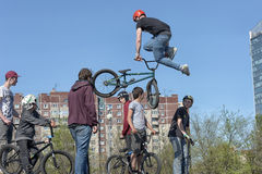 Boy rider jumps during an event of freestyle Stock Photography
