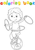 A boy rides a bicycle and juggling Stock Photos