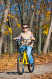 Boy rides a bicycle in park Royalty Free Stock Image