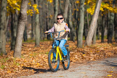 Boy rides a bicycle in park Stock Image