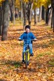 Boy rides a bicycle in park Stock Photos