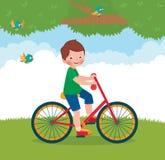 Boy rides a bike Stock Photos