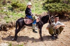 Boy rides a donkey Royalty Free Stock Photography