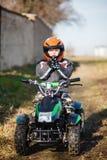 Boy rides on electric ATV quad. Stock Photo