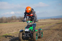 Boy rides on electric ATV quad. Royalty Free Stock Image