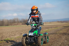 Boy rides on electric ATV quad. Stock Photography