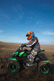 Boy rides on electric ATV quad. Stock Images