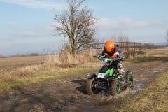 Boy rides on electric ATV quad. A little boy rides his electric ATV quad Stock Photo