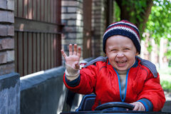 Boy rides on electric car Royalty Free Stock Photography