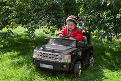 Boy rides on electric car Royalty Free Stock Images