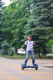 A boy rides gyroscooter Royalty Free Stock Images