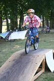 Boy rides his bike over a ramp during skill training