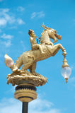 Boy rides horse in Thai Style as street lamp Royalty Free Stock Photography