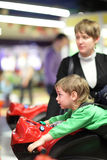 Boy rides a motorcycle simulator Stock Images