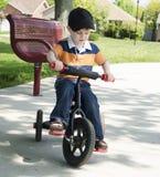 Boy rides trike Stock Image
