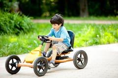 Boy rides a velomobile Stock Photography
