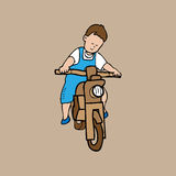 Boy rides wood motorcycle Stock Image