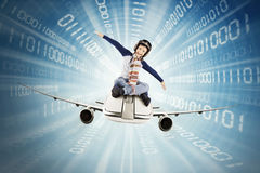 Boy riding airplane inside binary code Royalty Free Stock Image