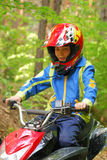 Boy riding ATV Stock Photo