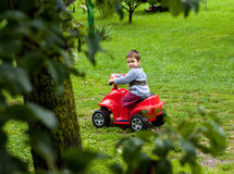 Boy riding atv toy Royalty Free Stock Photo