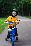 Boy riding bicycle. Young boy riding bicycle with training wheels Royalty Free Stock Image